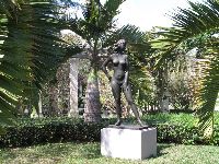 Statue among the little palms.