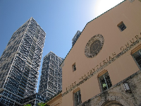 Old and new: The First Presbyterian Church with its late Mediterranean Revival architecture, and a modern skyscraper.
