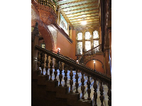 Stunning staircase and tiffany glass arched windows in Ponce de Leon Hall.