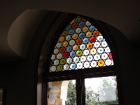Stained glass window with colored circles in the library.