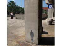 Painted shadow on the pillar in the football stadium- so cool!
