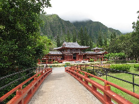 The red bridge that leads to the temple.