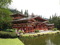 The pond in front of the temple with pretty, green banks.