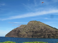 Paraglider, cliffs, and lighthouse.