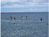 Kayaker and snorkelers at one of the three flat rocks.