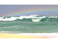 Rainbow over the winter waves.