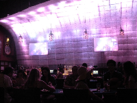 The pink lit-up wave wall at the bar.