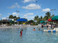 A child enjoying the shallow water at the splash playground.