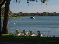 Adirondack chairs greet the morning sun. See the sloped deck for Rollins College students out in the water.