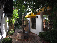 Spanish fountain and yellow awning.