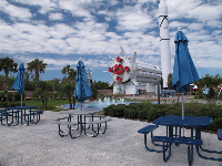 Picnic tables and splash pad at the rocket garden.