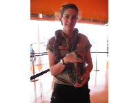 A staff member holds a snake for us to see!