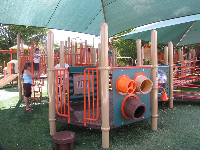 The varied playground, with shade covering.