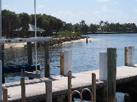 A dock with a curve of sand behind.