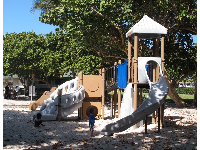 The playground with white sand below.
