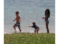 Children playing in the water of the Jupiter Inlet.