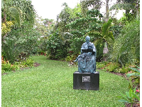 Statue in the middle of a lawn.