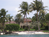 Beautiful mansion on Jupiter Island with coconut trees and flowers!