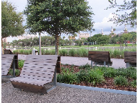 Benches that line the riverfront boardwalk.