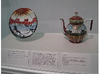 Communist propaganda on Russian teapot and plate from 1928 and 1932.