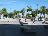 Skate park with a huge chunk of cool shade.