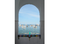 "View of harbor through ""Via Casino"" archway."