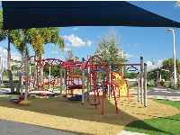 Shade canopies are dotted about the playground.