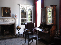 The room where the husband entertained his male guests, in the plantation house.