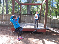 Tightrope walking at Camp Highland Outpost, behind SkyHike in the village.