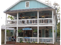 Cute architecture of Back Porch Oyster Bar, with large porch and balcony.