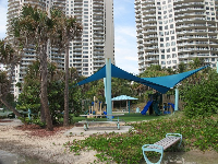 The playground, with apartment buildings behind it.