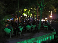 Square Grouper is a popular spot to grab a drink and listen to live music under the coconut trees.