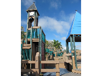 The faux wooden play structure with castle towers.