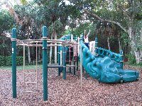 A girl climbs on the playground.