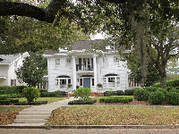 White mansion with columns.
