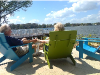 "A sweet older couple sitting by the lake. He said, ""I'd love a backyard like this!"""