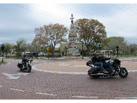 Bikers guys at the roundabout in front of the odd stone monument.