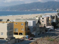 Beachhouses, situated along the 1 Highway and Santa Monica Beach, as seen from Palisades Park. Notice the beautiful, beautiful mountains!