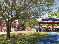 Large gazebo with picnic tables, and playground.