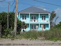 I love this Caribbean-colored house between Bathtub Beach and Chastain Beach.