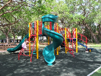 Playground with steep twisty slide.