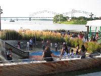 Parents enjoy a view of Mud Island across the water while kids get wet at the splash pad.