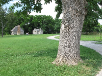 The peaceful grounds, with slave houses in the distance.