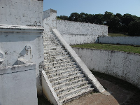 Climb the white stairs of the Spanish fort!