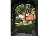 The herb garden and Spanish fountain, as seen through the archway.