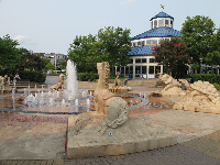 Horse, tortoise, and elephant sculptures at the splash pad.