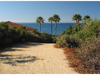 The trail, open to the public, that leads down to the beach.