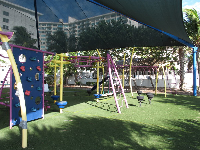 Playground under a shade canopy.