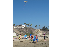 A family flies a kite on the northern end of Pismo Beach.