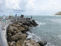Fishermen on the end of the jetty.